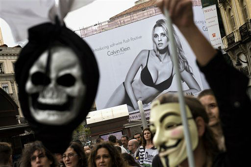 "<div class=""meta ""><span class=""caption-text "">Demonstrators take part in a march to the Spanish Parliament against the austerity measures announced by the Spanish government in Madrid, Spain, Tuesday, Sept. 25, 2012. Spain's government was hit hard by the country's financial crisis on multiple fronts Tuesday as protestors enraged with austerity cutbacks and tax hikes clashed with police near Parliament, a separatist-minded region set elections seen as an independence referendum and the nation's high borrowing costs rose again. (AP Photo/Daniel Ochoa De Olza) (AP Photo/ Daniel Ochoa De Olza)</span></div>"