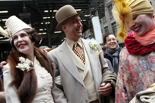 "<div class=""meta ""><span class=""caption-text "">Dressed for the occasion, Gretchen Fenston, left, Roddy Caravella, second from left, and Kathleen McGowan, right, all from the Brooklyn borough of New York, pose for photographs on New York's Fifth Avenue as they take part in the Easter Parade Sunday March 31, 2013. (AP Photo/Tina Fineberg) (AP Photo/ Tina Fineberg)</span></div>"
