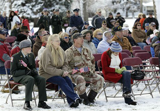 U.S. military veterans, family members, and supporters listen to a speaker during a Veterans Day ceremony in the small town of Loveland, Colo., Sunday Nov. 11, 2012. &#40;AP Photo&#47;Brennan Linsley&#41; <span class=meta>(AP Photo&#47; Brennan Linsley)</span>