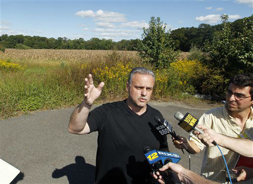 West Windsor police Lt. Robert Garofolo answers a question as he stands near a cornfild where a helicopter crashed Saturday, Sept. 15, 2012, in West Windsor, N.J. Garofolo said that police received witness reports that the helicopter struck a flock of birds shortly before crashing in a corn field. &#40;AP Photo&#47;Mel Evans&#41; <span class=meta>(AP Photo&#47; Mel Evans)</span>