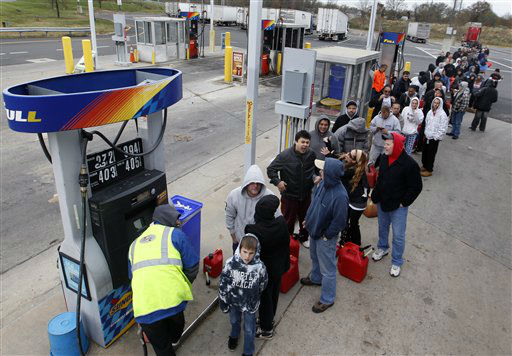 People line up to fill gas containers at the New Jersey Turnpike&#39;s Thomas A. Edison service area Wednesday, Oct. 31, 2012, near Woodbridge, N.J. After Monday&#39;s storm surge from Sandy, many gas stations in the region are without power and those that are open have very long lines. &#40;AP Photo&#47;Mel Evans&#41; <span class=meta>(AP Photo&#47; Mel Evans)</span>