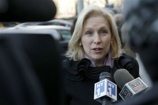 New York Senator Kirsten Gillibrand speaks to media as she arrives for the funeral of  former New York City Mayor Ed Koch in New York, Monday, Feb. 4, 2013. Koch was remembered as the quintessential New Yorker during a funeral that frequently elicited laughter, recalling his famous one-liners and amusing antics in the public eye. Koch died Friday of congestive heart failure at age 88. &#40;AP Photo&#47;Seth Wenig&#41; <span class=meta>(AP Photo&#47; Seth Wenig)</span>