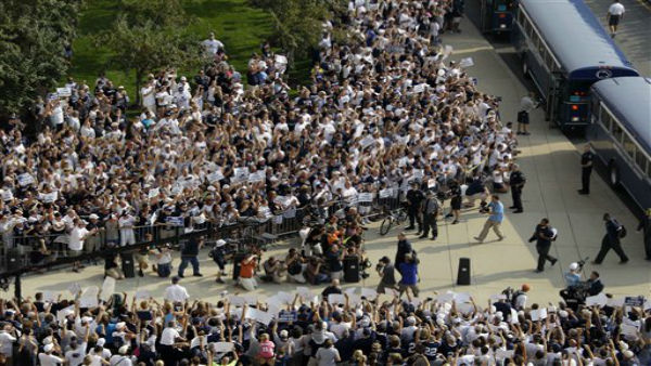 Penn State football fans surround the Penn State football team buses as Penn State head coach Bill O&#39;Brien, center, leads his team into Beaver Stadium for their season opener against Ohio in State College, Pa., Saturday, Sept. 1, 2012. &#40;AP Photo&#47;Gene J. Puskar&#41; <span class=meta>(AP Photo&#47; Gene J. Puskar)</span>
