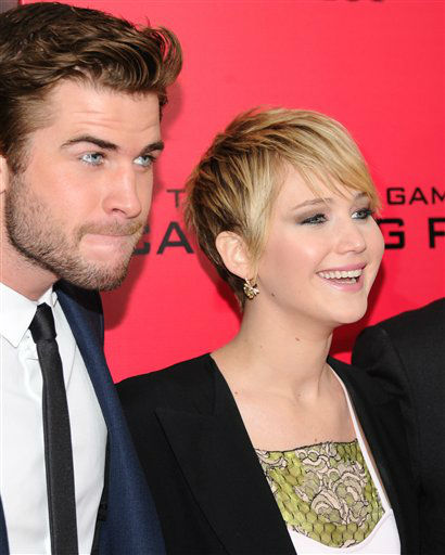 "Actors Liam Hemsworth and Jennifer Lawrence attend a special screening of ""The Hunger Games: Catching Fire"" at AMC Lincoln Square on Wednesday, Nov. 20, 2013 in New York. (Photo by Evan Agostini/Invision/AP)"
