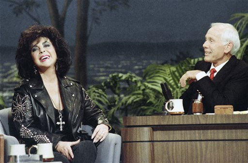 Actress Elizabeth Taylor and Tonight Show host Johnny Carson share a laugh during Taylor?s first-ever appearance on the show at night on Monday, Feb. 21, 1992 in Los Angeles. &#40;AP Photo&#47;Bob Galbraith&#41; <span class=meta>(AP Photo&#47; Bob Galbraith)</span>
