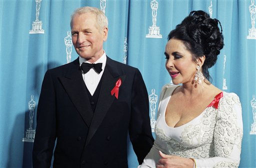 Elizabeth Taylor, with Paul Newman at the Academy Awards in March 30, 1992 at the Chandler Pavilion in Los Angeles. They are presenting the Academy Award for best picture at the ceremony. &#40;AP Photo&#47;Bob Galbraith&#41; <span class=meta>(AP Photo&#47; Bob Galbraith)</span>