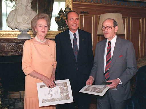 Paris Mayor Jacques Chirac, center, poses with Washington Post Company President Katharine Graham, left, and New York Times Comany President Arthur Ochs Sulzberger May 26,1992 after awarding them the Paric City Medal at the townhall. Graham and Sulzberger were in Paris to attend a ceremony marking the 25th anniversary of the International Herald Tribune. &#40;AP Photo&#47;Jose Goita&#41; <span class=meta>(AP Photo&#47; JOSE GOITA)</span>