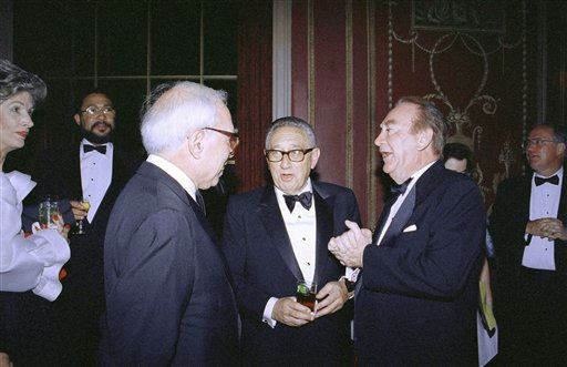 Former New York Governor Hugh Carey, right, chats with former Secretary of State Henry Kissinger prior to the Annual Rockefeller Public Service Award Dinner in New York, Thursday, June 4, 1992. Carey received the fifth annual Nelson A. Rockefeller Public Service Award during the affair for his work in Congress and to New York state. &#40;AP photo&#47;Luiz Ribeiro&#41; <span class=meta>(AP Photo&#47; Luiz Ribeiro)</span>