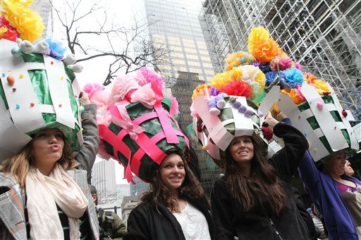 "<div class=""meta image-caption""><div class=""origin-logo origin-image ""><span></span></div><span class=""caption-text"">Wearing Easter gardens on their heads, the Woram sisters, from Toms River, N.J., pose for photographs on New York's Fifth Avenue as they take part in the Easter Parade, Sunday, March 31, 2013. (AP Photo/Tina Fineberg) (AP Photo/ Tina Fineberg)</span></div>"