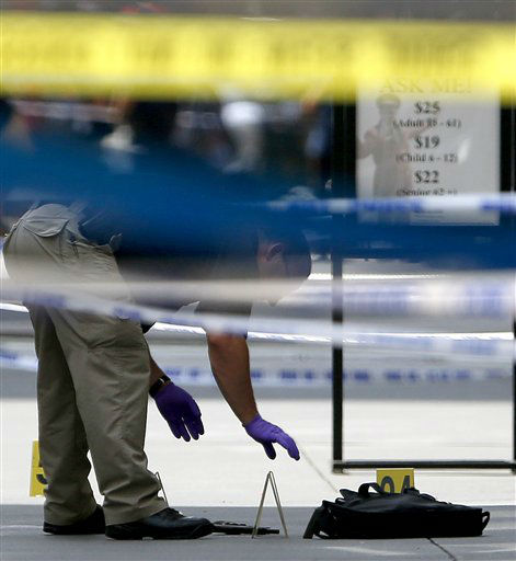 An official inspects evidence near the Empire State Building in New York following a shooting Friday, Aug. 24, 2012. Police say a recently laid-off worker shot a former colleague to death near the iconic skyscraper, then randomly opened fire on people nearby before firing on police. New York City Mayor Michael Bloomberg said some of the victims may have been hit by police bullets as police and the gunman exchanged fire. &#40;AP Photo&#47;Julio Cortez&#41; <span class=meta>(AP Photo&#47; Julio Cortez)</span>