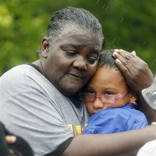Danessa Lee, left, comforts her granddaughter Ashanti Lee, 12, after their family was rescued in Pearlington, Miss., by law enforcement officers and first responders using boats, Wednesday, Aug. 29, 2012, during the nonstop rain from Isaac. A number of residents of the small community were trapped by the rising waters and had be rescued or waited until the low tide when waters receded so they could walk out. &#40;AP Photo&#47;Rogelio V. Solis&#41; <span class=meta>(AP Photo&#47; Rogelio V. Solis)</span>