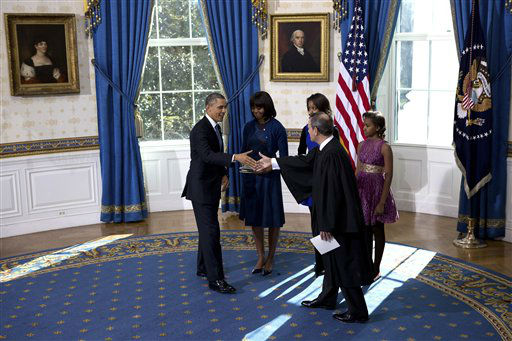 President Barack Obama shakes hands after being officially sworn-in by Chief Justice John Roberts in the Blue Room of the White House during the 57th Presidential Inauguration in Washington, Sunday Jan. 20, 2013, with first lady Michelle Obama and daughters Malia and Sasha watching. &#40;AP Photo&#47;The New York Times, Doug Mills, Pool&#41; <span class=meta>(AP Photo&#47; Doug Mills)</span>