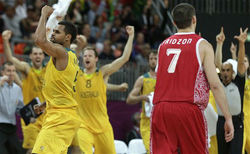Australia&#39;s Patrick Mills pumps his fist after hitting the game-winning 3-point shot to pull ahead of Russia with time expiring during a men&#39;s basketball game at the 2012 Summer Olympics, Monday, Aug. 6, 2012, in London. At right is Russia&#39;s Vitaliy Fridzon. &#40;AP Photo&#47;Charles Krupa&#41; <span class=meta>(AP Photo&#47; Charles Krupa)</span>