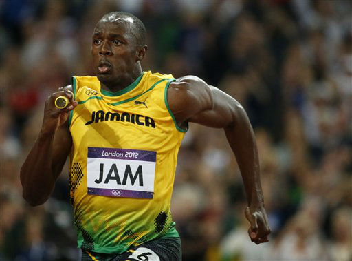 "<div class=""meta ""><span class=""caption-text "">Jamaica's Usain Bolt competes to win gold in the men's 4x100-meter relay final during the athletics in the Olympic Stadium at the 2012 Summer Olympics, London, Saturday, Aug. 11, 2012. Jamaica set a new world record with a time of 36.84 seconds. (AP Photo/Matt Dunham) (AP Photo/ Matt Dunham)</span></div>"