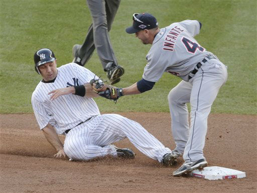 New York Yankees&#39; Raul Ibanez is tagged out   trying to steal second base by Detroit Tigers&#39; Omar Infante in the fourth inning of Game 2 of the American League championship series Sunday, Oct. 14, 2012, in New York. &#40;AP Photo&#47;Charlie Riedel&#41; <span class=meta>(AP Photo&#47; Charlie Riedel)</span>
