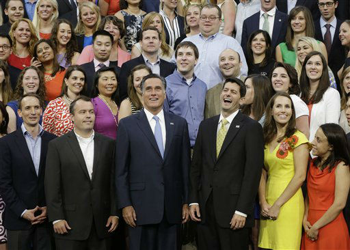 Republican presidential nominee Mitt Romney and Republican vice presidential nominee, Rep. Paul Ryan pose with their campaign staff for a group picture at the Republican National Convention in Tampa, Fla., on Thursday, Aug. 30, 2012.&#40;AP Photo&#47;Charles Dharapak&#41; <span class=meta>(AP Photo&#47; Charles Dharapak)</span>