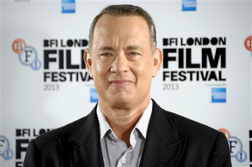 FILE - This Oct. 9, 2013 file photo shows U.S actor Tom Hanks at the &#34;Captain Phillips&#34; photocall for the BFI London Film Festival in central London. Hanks was nominated for a Golden Globe for best actor in a motion picture drama for his role in the film on Thursday, Dec. 12, 2013.  The 71st annual Golden Globes will air on Sunday, Jan. 12. &#40;Photo by Jonathan Short&#47;Invision&#47;AP, File&#41; <span class=meta>(Photo&#47;Jonathan Short)</span>