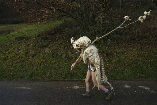 A man dressed as a &#39;Momotxorro&#39; a natural entity made of bones and sheep skin walks to take part on a Carnival in the Basque village of Zubieta, Monday, Jan. 28, 2013.In one of the most ancient carnivals in Europa , dating from before the Roman empire, companies of Joaldunak &#40;cowbells&#41; and Momotxorros parade between the villages of Zubieta and Ituren.&#40;AP Photo&#47;Daniel Ochoa de Olza&#41; <span class=meta>(AP Photo&#47; Daniel Ochoa De Olza)</span>