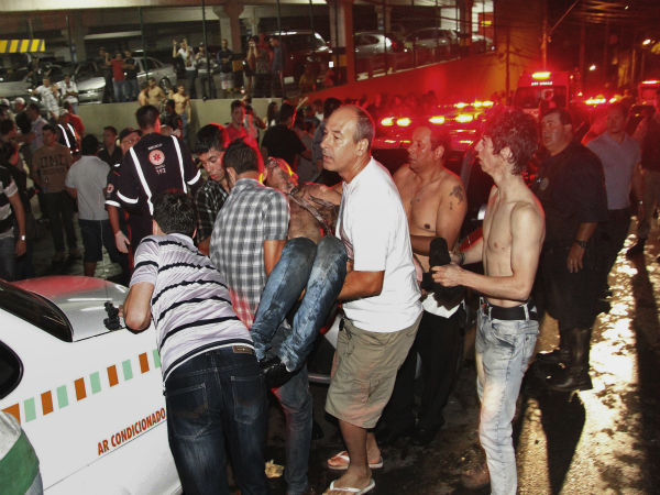 "<div class=""meta ""><span class=""caption-text "">A victim of a fire in a club is carried in Santa Maria city, Rio Grande do Sul state,  Brazil,  early Sunday,  Jan. 27,  2013.  According to police more than 200 died in the devastating nightclub fire in southern Brazil.  Officials say the fire broke out at the Kiss club in the city of Santa Maria while a band was performing. At least 200 people were also injured.  (AP Photo/Deivid Dutra/Agencia Freelancer) (AP Photo/ Deivid Dutra)</span></div>"