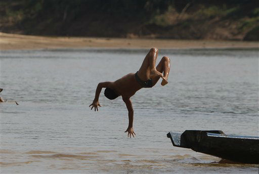 "<div class=""meta ""><span class=""caption-text "">A boy dives into the Isiboro river on the outskirts of San Miguelito, part of the TIPNIS reserve, Bolivia, Sunday, July 29, 2012. Members of 69 Indigenous communities are holding a referendum to decide if they accept a project of the Bolivian government to build a road across the TIPNIS reserve. The project faces opposition from Amazon indigenous groups, Bolivia's President Evo Morales former allies, who split with him over it. (AP Photo/Juan Karita) (AP Photo/ Juan Karita)</span></div>"