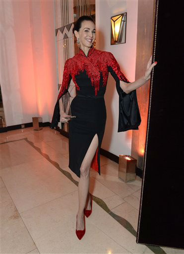 Fashion Designer L'Wren Scott, winner of the Harper's Bazaar Tastemaker of the Year Award poses for photographers during Harper's Bazaar Women of the Year Awards 2013 at Claridge's Hotel on Tuesday, Nov. 5, 2013, in London. (Photo by Jon Furniss/Invision for Harper's Bazaar/AP)