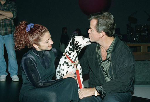 Dick Clark, right, gets a lick from his dalmation Lucille as singer Gloria Estefan looks on during a break in rehearsals for the American Music Awards in Los Angeles, Calif., Jan. 24, 1993.  Estefan gave the pooch to Clark as a pup and Clark brought the dog so Estefan could see how much she had grown.  &#40;AP Photo&#41; <span class=meta>(AP Photo&#47; XNBG)</span>