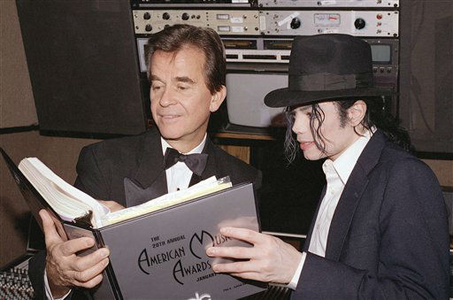 FILE - In this Jan. 24, 1993 file photo, singer Michael Jackson and American Music Awards executive producer Dick Clark go over the script during rehearsals for The American Music Awards at the Shrine Auditorium in Los Angeles. Clark, the television host who helped bring rock `n&#39; roll into the mainstream on &#34;American Bandstand,&#34; died Wednesday, April 18, 2012 of a heart attack. He was 82. &#40;AP Photo&#47;file&#41; <span class=meta>(AP Photo&#47; Anonymous)</span>