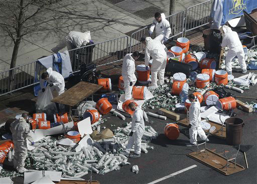 Investigators comb through the post finish line area of the Boston Marathon at Boylston Street, two days after two bombs exploded just before the finish line, Wednesday, April 17, 2013, in Boston. &#40;AP Photo&#47;Julio Cortez&#41; <span class=meta>(AP Photo&#47; Julio Cortez)</span>