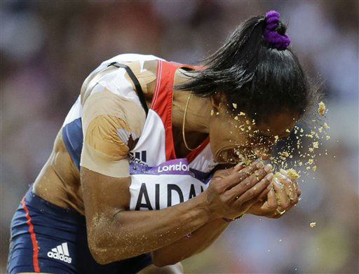 Britain&#39;s Yamile Aldama reacts during the women&#39;s triple jump final during the athletics in the Olympic Stadium at the 2012 Summer Olympics, London, Sunday, Aug. 5, 2012. &#40;AP Photo&#47;David J. Phillip &#41; <span class=meta>(AP Photo&#47; David J. Phillip)</span>
