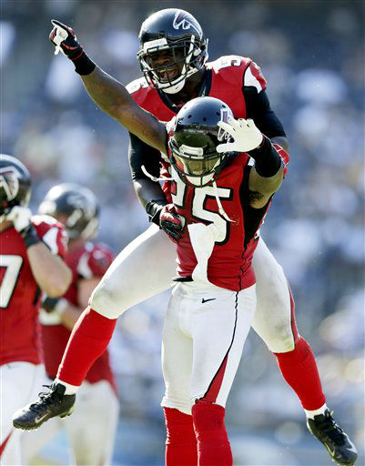 Atlanta Falcons linebacker Sean Weatherspoon, top, and strong safety William Moore celebrate after a call was reversed and Moore was given a fumble recovery after San Diego Chargers wide receiver Malcom Floyd lost the ball in the fourth quarter of an NFL football game, Sunday, Sept. 23, 2012, in San Diego. The Falcons won 27-3. &#40;AP Photo&#47;Gregory Bull&#41; <span class=meta>(AP Photo&#47; Gregory Bull)</span>