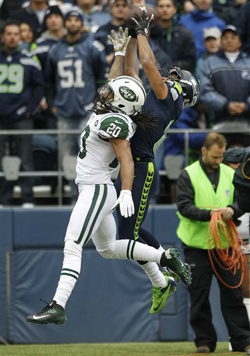 Seattle Seahawks&#39; Golden Tate, right, makes a catch for a touchdown over New York Jets&#39; Kyle Wilson in the first half of an NFL football game, Sunday, Nov. 11, 2012, in Seattle. &#40;AP Photo&#47;Elaine Thompson&#41; <span class=meta>(AP Photo&#47; Elaine Thompson)</span>