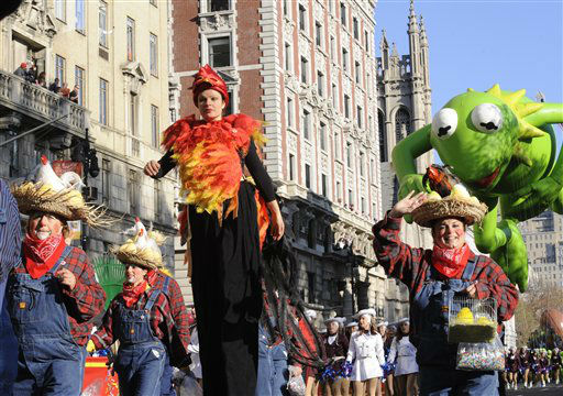 Costumed characters and a marching band precede the Kermit The Frog balloon on New York&#39;s Central Park West during the 86th annual Macy&#39;s Thanksgiving Day Parade,Thursday, Nov 22, 2012. &#40;AP Photo&#47; Louis Lanzano&#41; <span class=meta>(AP Photo&#47; Louis Lanzano)</span>