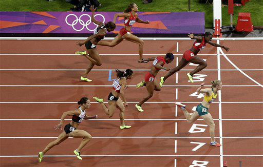 "<div class=""meta ""><span class=""caption-text "">Australia's Sally Pearson crosses the finish line for a gold medal win in the women's 100-meter hurdles final during the athletics in the Olympic Stadium at the 2012 Summer Olympics, London, Tuesday, Aug. 7, 2012. (AP Photo/Mark Baker) (AP Photo/ Mark Baker)</span></div>"