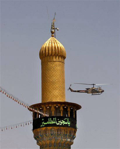 An Iraqi military helicopter flies over pilgrims gathered at the holy shrine of the Imam Moussa al-Kadhim during the annual commemoration of the saint&#39;s death at Kazimiyah district of Baghdad, Iraq, Wednesday, June 5, 2013. &#40;AP Photo&#47; Karim Kadim&#41; <span class=meta>(AP Photo&#47; Karim Kadim)</span>