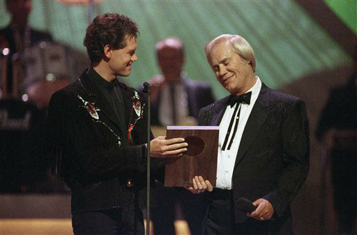 Country music legend George Jones accepts his Country Music Hall of Fame award from Randy Travis, left, during the Country Music Association Awards show, Sept. 30, 1992, Nashville, Tenn. &#40;AP Photo&#47;Mark Humphrey&#41; <span class=meta>(AP Photo&#47; Mark Humphrey)</span>