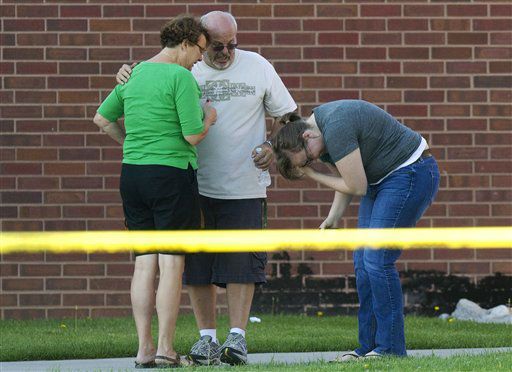 "<div class=""meta image-caption""><div class=""origin-logo origin-image ""><span></span></div><span class=""caption-text"">Tom Sullivan, center, stands with family members outside Gateway High School where witness were brought for questioning after a gunman opened fire at the midnight premiere of The Dark Knight Rises Batman movie Friday, July 20, 2012 in Aurora, Colo. Sullivan later pleaded with the media to help find his missing son, Alex Sullivan, who attended the movie to celebrate his 27th birthday.   A gunman wearing a gas mask set off an unknown gas and fired into the crowded movie theater killing 12 people and injuring at least 50 others, authorities said. (AP Photo/Barry Gutierrez) (AP Photo/ Barry Gutierrez)</span></div>"