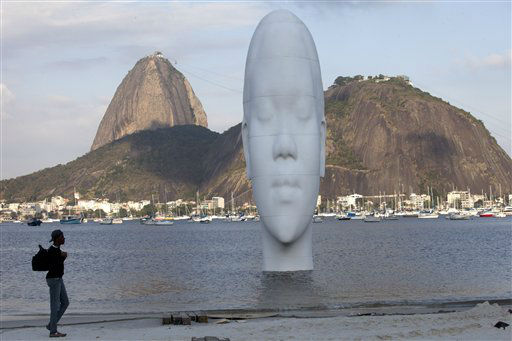 &#34;Awilda&#34;, a sculpture by Spanish artist Jaume Plensa, emerges from Guanabara Bay in Rio de Janeiro, Brazil, Monday, Sept. 3, 2012. Awilda, a 12-meter-high sculpture depicting a woman, is part of the art exhibition &#34;OIR&#34; or Other Ideas for Rio where installations will be placed in public places. &#40;AP Photo&#47;Silvia Izquierdo&#41; <span class=meta>(AP Photo&#47; Silvia Izquierdo)</span>