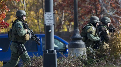 Police and swat team members respond to a call of a shooting at the Azana Spa in Brookfield, Wis. Sunday , Oct. 21, 2012.  Multiple people were wounded when someone opened fire at the spa near the Brookfield Square Mall. Deputies are still looking for the gunman. &#40;AP Photo&#47;Tom Lynn&#41; <span class=meta>(AP Photo&#47; Tom Lynn)</span>