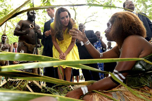 Britain&#39;s Kate, center, the Duchess of Cambridge, speaks with a traditional weaver during a visit to a cultural village in Honiara, Solomon Islands, Monday, Sept. 17, 2012. Britain&#39;s Prince William, the Duke of Cambridge, and his wife Kate are on their third stop of a nine-day tour of Southeast Asia and the South Pacific on behalf of Queen Elizabeth II to commemorate her Diamond Jubilee. &#40;AP Photo&#47;William West, Pool&#41; <span class=meta>(AP Photo&#47; William West)</span>