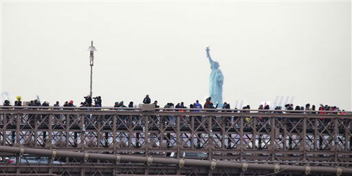 People organized by a gun control group formed in the wake of last month&#39;s massacre at a Connecticut elementary school march across the Brooklyn Bridge on Monday, Jan. 21, 2013, in New York. Organizers One Million Moms for Gun Control want Congress to follow New York&#39;s lead and enact stricter limits on weapons and ammunition purchases. &#40;AP Photo&#47;Peter Morgan&#41; <span class=meta>(AP Photo&#47; Peter Morgan)</span>