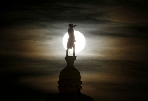 A bronze statue of General George Washington by William Rudolf O&#39;Donovan stands on top of the Trenton Battle Monument while silhouetted by a the light of a full moon shinning on clouds, Thursday, Nov. 29, 2012, in Trenton, N.J. The monument commemorates the victory at the first Battle of Trenton, which occurred on Dec. 26, 1776, and is located where the artillery dominated the streets of Trenton, preventing the Hessian troops from organizing attacks. &#40;AP Photo&#47;Julio Cortez&#41; <span class=meta>(AP Photo&#47; Julio Cortez)</span>