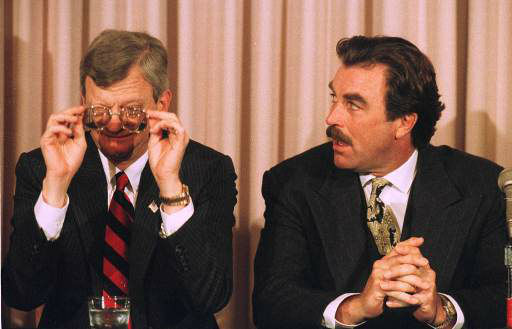 Author Tom Clancy, left, adjusts his glasses as actor Tom Selleck looks on, in this January 5, 1994 photo.  &#40;AP Photo&#47;Paul Sakuma&#41; <span class=meta>(AP Photo&#47; PAUL SAKUMA)</span>
