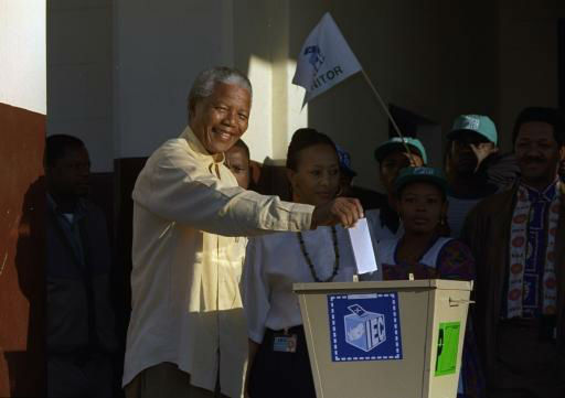 "<div class=""meta image-caption""><div class=""origin-logo origin-image ""><span></span></div><span class=""caption-text"">ANC leader Nelson Mandela casts his vote at Ohlange High School hall in Inanda, 10 miles (15 kilometers) north of Durban, Wednesday, April 27, 1994 for South Africa's first all-race elections.  (AP Photo/John Parkin) (AP Photo/ JOHN PARKIN)</span></div>"