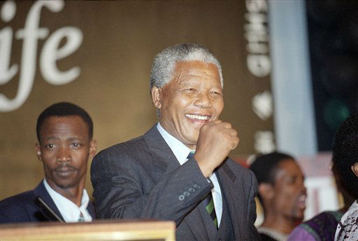 Nelson Mandela smiles during his victory speech in Johannesburg on Monday May 2, 1994. Mandela will become  South Africa&#39;s first black president following his majority win in the historic all-race elections. &#40;AP Photo&#47;John Parkin&#41; <span class=meta>(AP Photo&#47; John Parkin)</span>