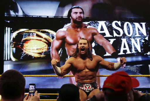 "<div class=""meta image-caption""><div class=""origin-logo origin-image ""><span></span></div><span class=""caption-text"">Professional wrestler Mason Ryan celebrates his win over Percy Watson at Wrestlemania Axxess event Saturday, April 6, 2013, in East Rutherford, N.J., ahead of Sunday's Wrestlemania at MetLife stadium. (AP Photo/Mel Evans) (AP Photo/ Mel Evans)</span></div>"