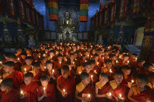 Novice Buddhist monks offer prayers for peace at the Tergar Monastery, the site of an explosion, in Bodh Gaya, about 130 kilometers &#40;80 miles&#41; south of Patna, the capital of the eastern Indian state of Bihar, Tuesday, July 9, 2013. One man has been detained and sketches of two others have been prepared as investigators searched for clues Monday into a series of blasts at some of Buddhism&#39;s holiest sites in Bodhgaya. &#40;AP Photo&#47;Manish Bhandari&#41; <span class=meta>(AP Photo&#47; Manish Bhandari)</span>