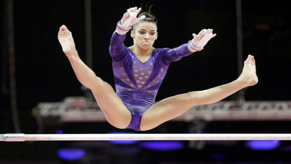 U.S. gymnast Alexandra Raisman performs on the uneven bars during the Artistic Gymnastics women&#39;s qualification at the 2012 Summer Olympics, Sunday, July 29, 2012, in London. &#40;AP Photo&#47;Gregory Bull&#41; <span class=meta>(AP Photo&#47; Gregory Bull)</span>