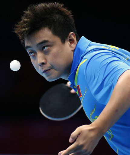 Wang Hao of China, serves against Zhang Jike of China during the gold medal match at men&#39;s singles table tennisat the 2012 Summer Olympics, Thursday, Aug. 2, 2012, in London. &#40;AP Photo&#47;Sergei Grits&#41; <span class=meta>(AP Photo&#47; Sergei Grits)</span>