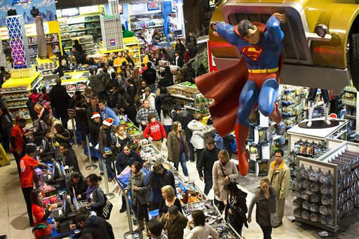Shoppers wait on a check-out line in the Times Square Toys-R-Us store after doors were opened to the public at 8 p.m. on Thursday, Nov. 22, 2012, in New York. While stores typically open in the wee hours of the morning on the day after Thanksgiving known as Black Friday, openings have crept earlier and earlier over the past few years. Now, stores from Wal-Mart to Toys R Us are opening their doors on Thanksgiving evening, hoping Americans will be willing to shop soon after they finish their pumpkin pie. &#40;AP Photo&#47;John Minchillo&#41; <span class=meta>(AP Photo&#47; John Minchillo)</span>