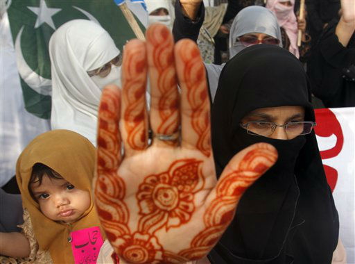Women supporters of Pakistani religious party Jamaat-e-Islami raise their hands to take oath to continue wear hijab &#40;veil&#41; during a rally in Karachi, Pakistan on Tuesday, Sept. 4, 2012.  Rallies were organized nationwide to observe the Hijab &#40;veil&#41; Day to highlight what the group sees as the importance and value of hijab for Muslim women. &#40;AP Photo&#47;Shakil Adil&#41; <span class=meta>(AP Photo&#47; Shakil Adil)</span>